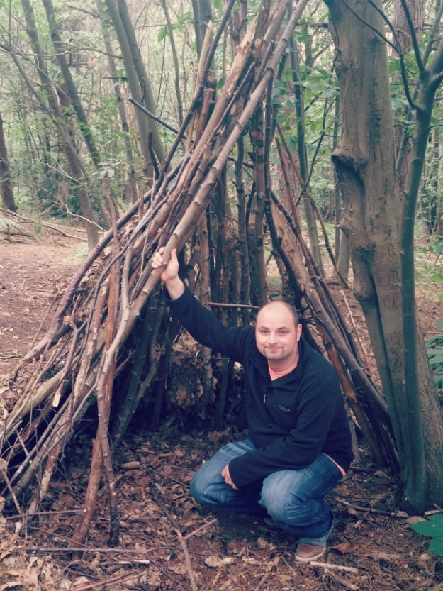 Wooden teepee den in Joyden's Wood