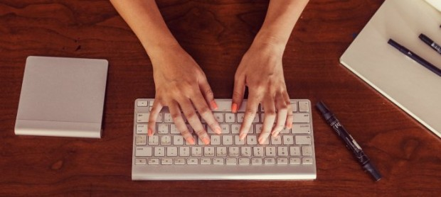 Girl typing on keyboard
